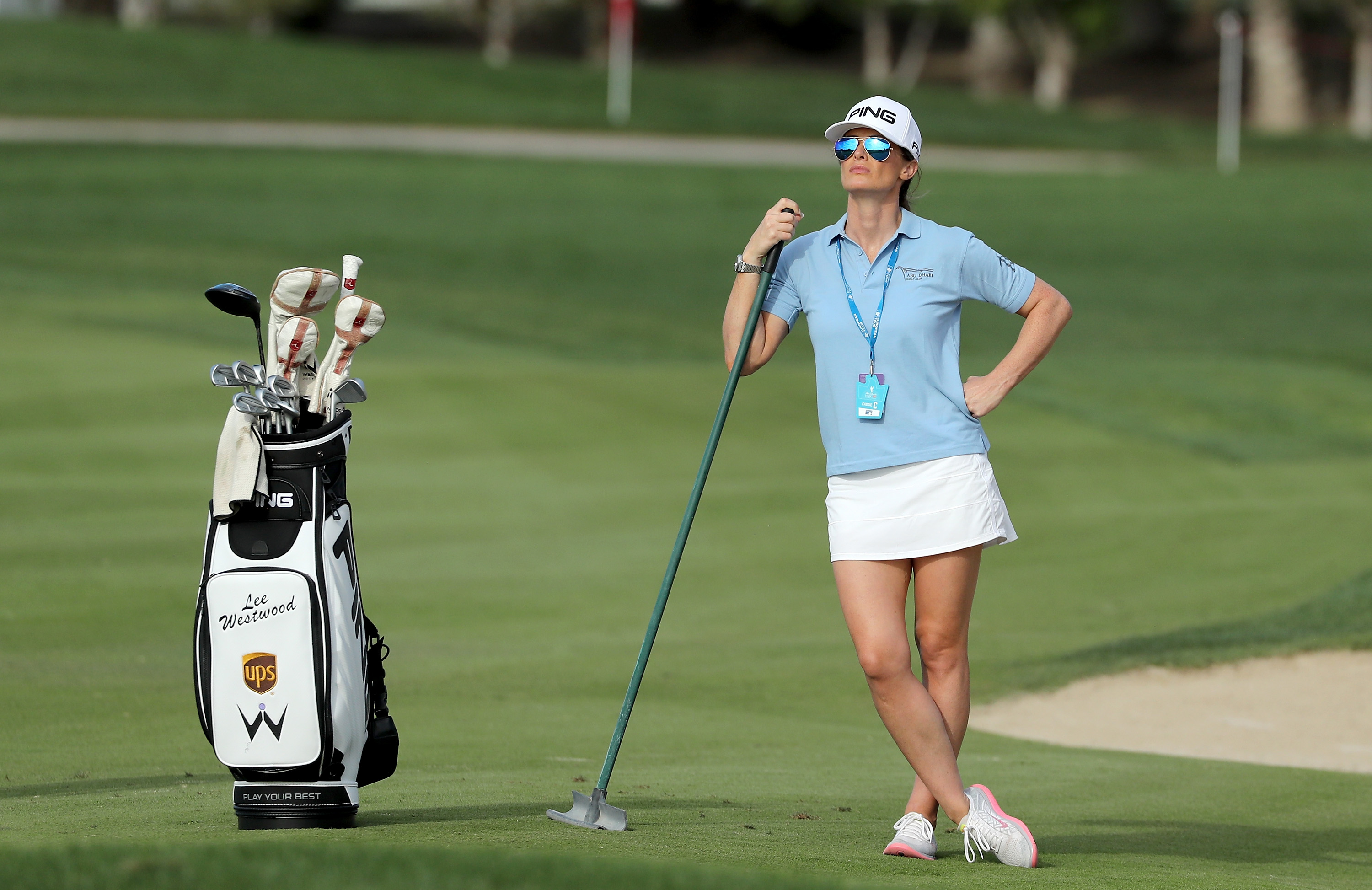 Westwood s girlfriend stands in as caddy in abu dhabi