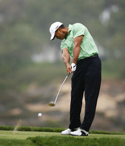 Tiger unloads the Stinger with his fairway metal