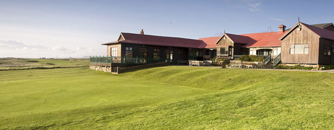 Rustic clubhouse and practice green