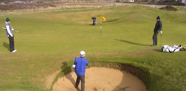 Bunkered at the par-3 7th hole