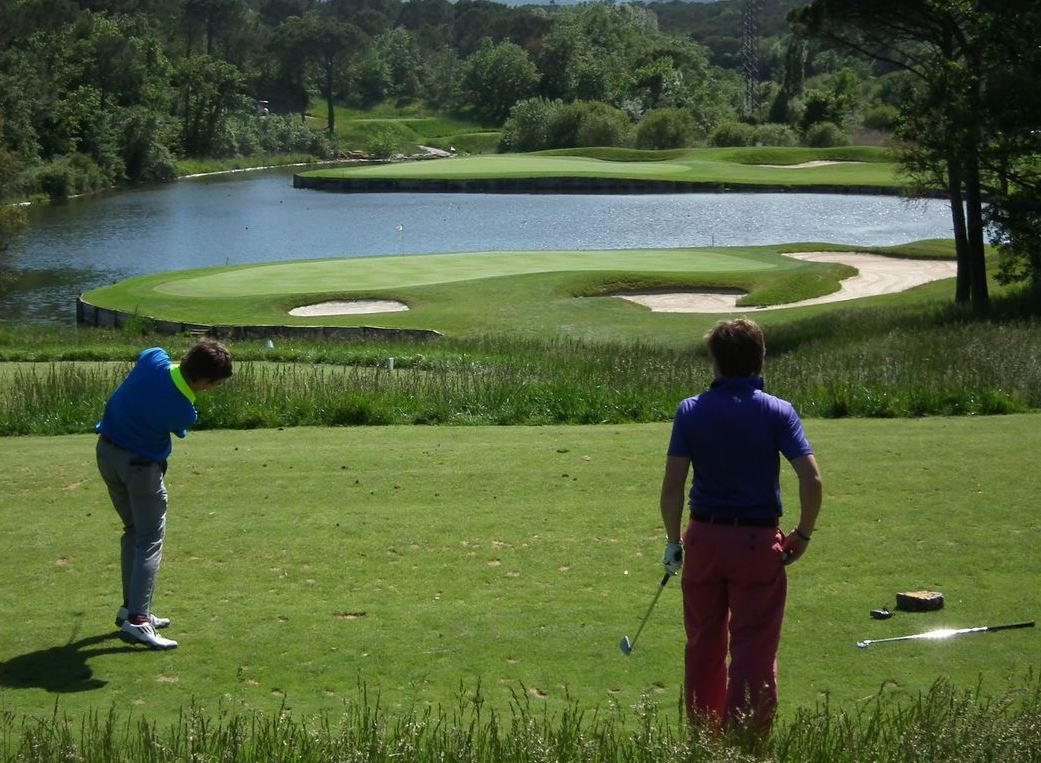 In action at the stunning par-3 11th