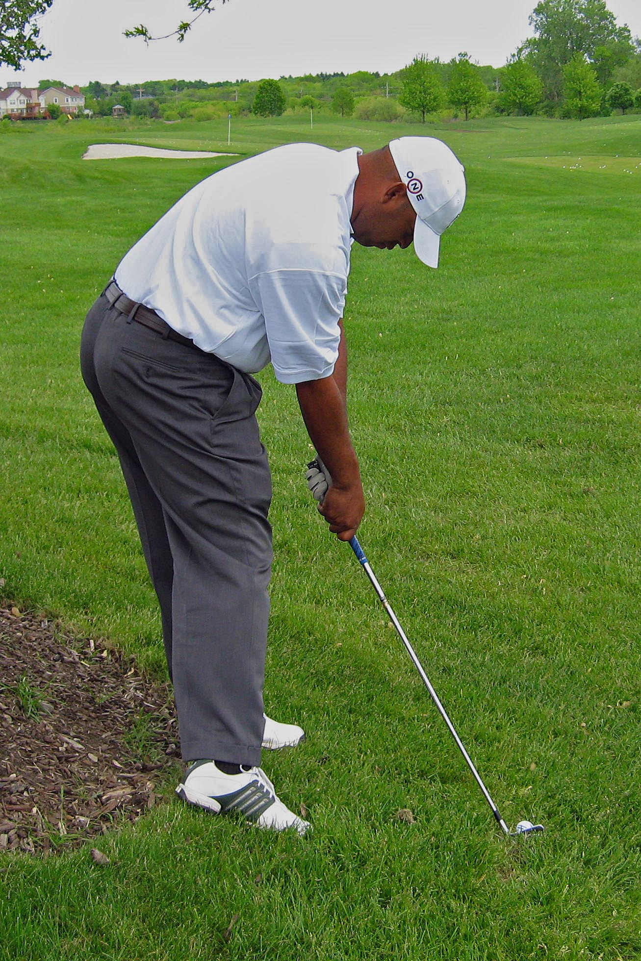 Grip up the club with a steeper swing path