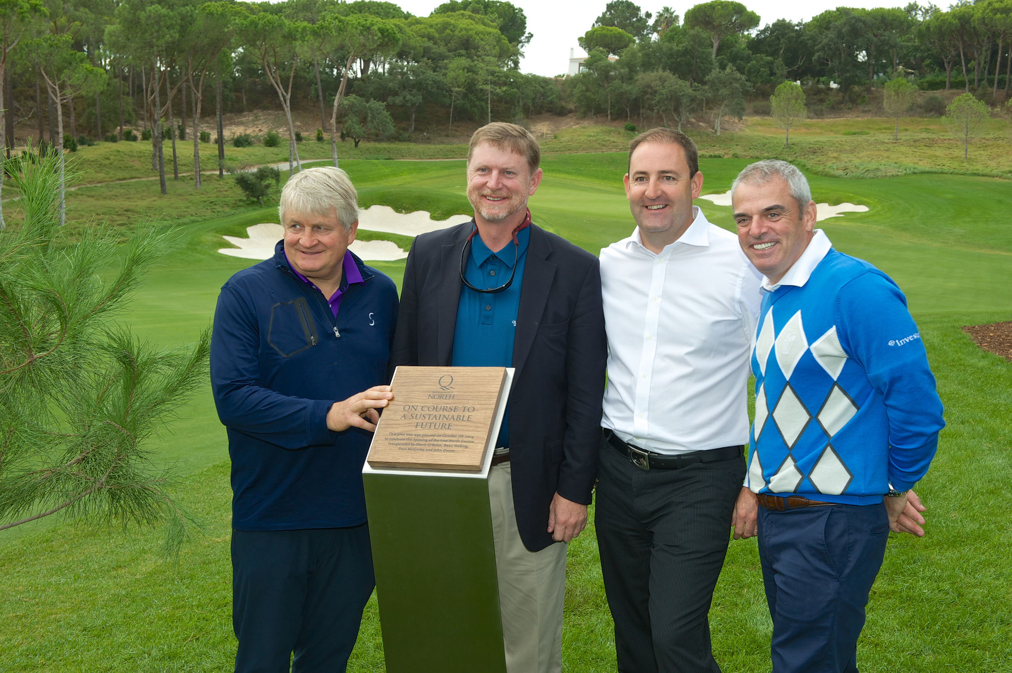 Beau Welling (second from left) and Paul McGinley (right) were in charge of the rebuild