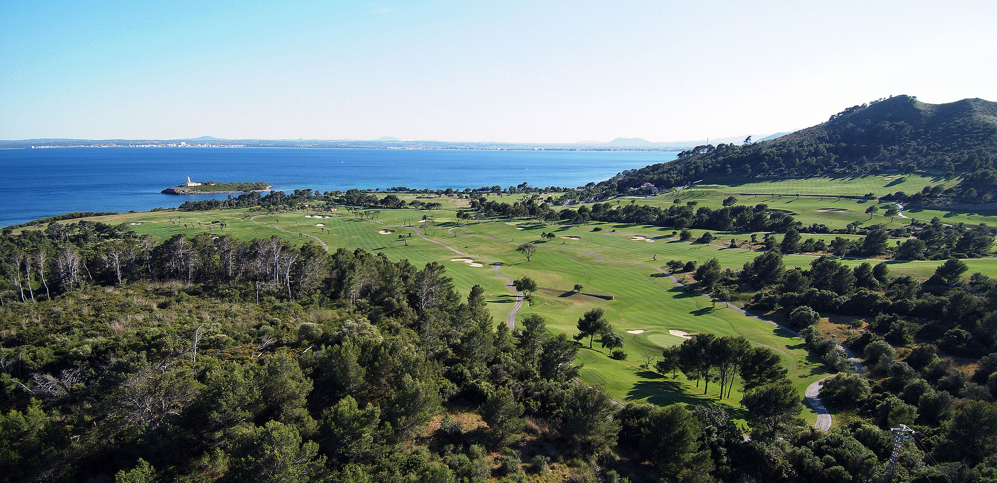Alcanada is Mallorca's only seaside course and looks across the Bay d'Alcudia
