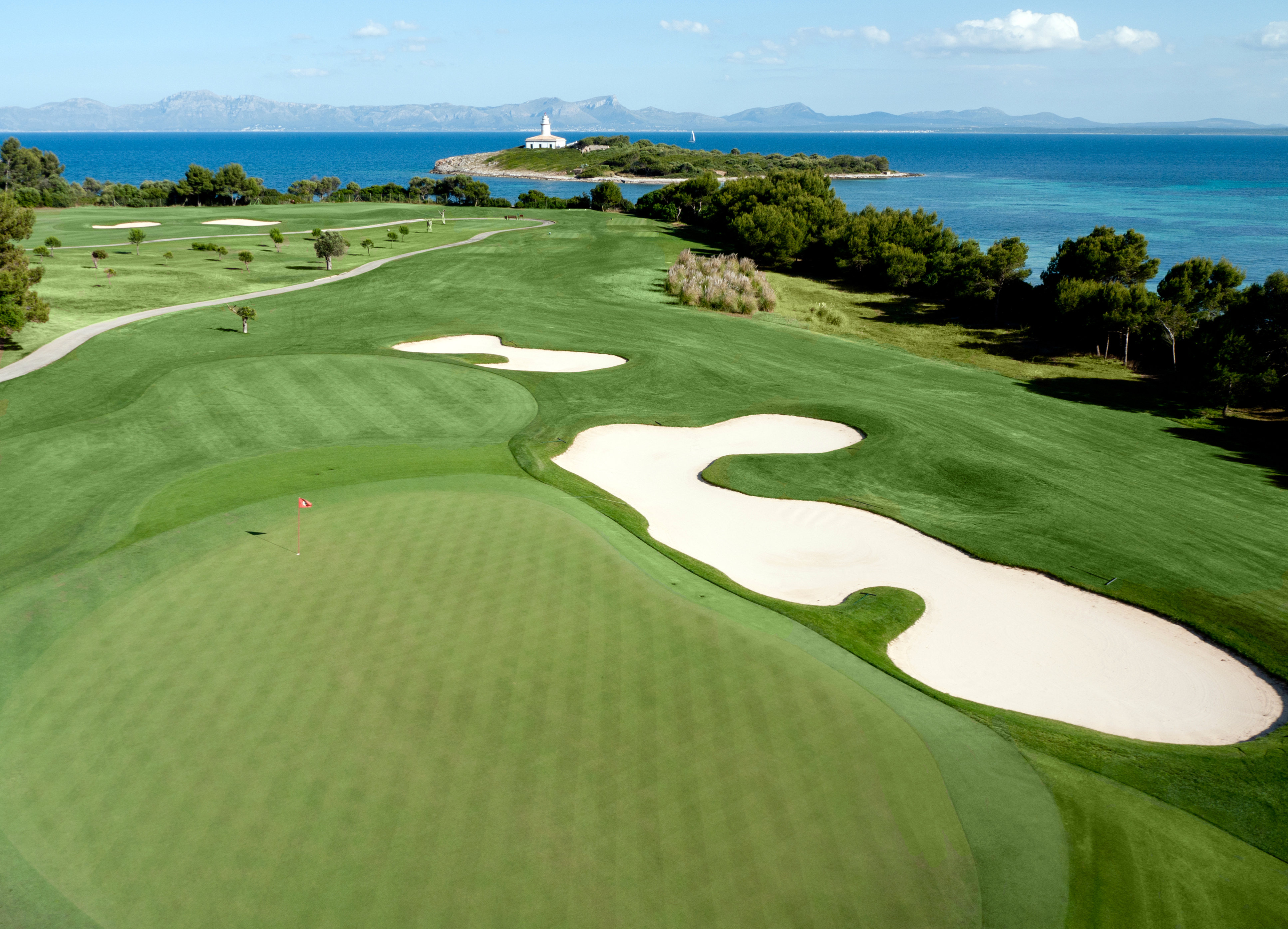 The par-three 17th green skirts the shore next to Bay d'Alcudia