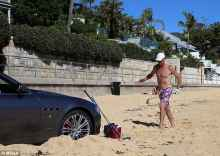 maserati drivers parks on beach to play golf and pump bob marley tunes