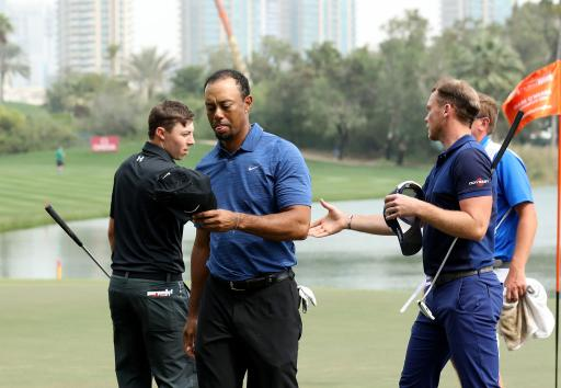 tiger woods withdraws from dubai with back injury