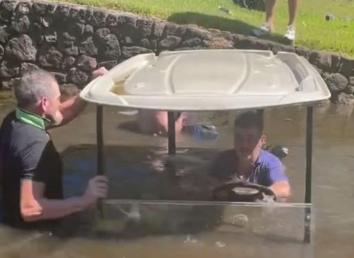 WATCH: Golf trip off to shocking start after golf cart finds the water!