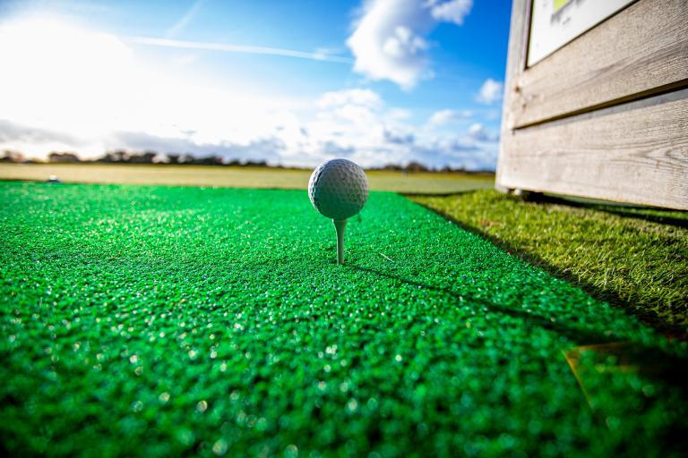 Golf fans react as Justine Ezarik hits golf ball with LIGHTSABER at TOPGOLF