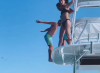 Dustin Johnson does OUTRAGEOUS backflip off a boat with Paulina Gretzky
