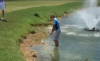 Golfer FALLS INTO LAKE after playing recovery shot!